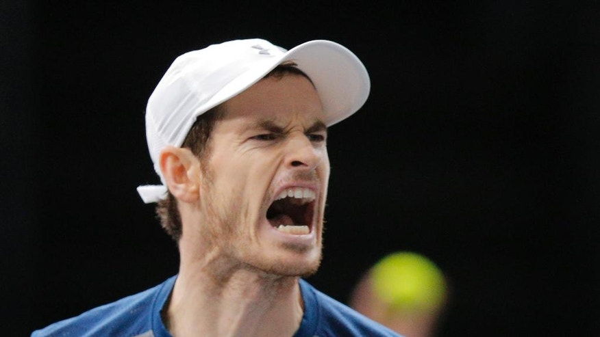 Britain's Andy Murray reacts after he breaks against John Isner of the United States during the final of the Paris Masters tennis tournament at the Bercy Arena in Paris, Sunday, Nov. 6, 2016. Murray won 6-3, 6-7, 6-4. (AP Photo/Michel Euler)