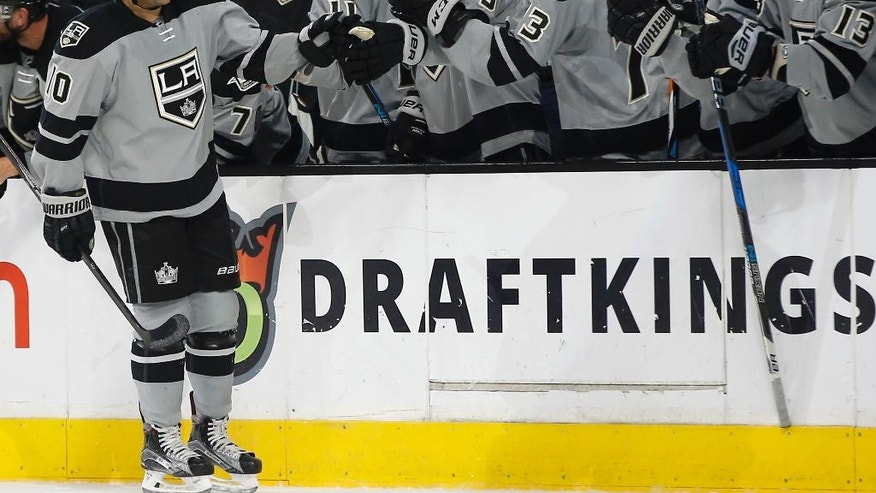 Los Angeles Kings right wing Devin Setoguchi, left, celebrates with teammates after scoring against the Calgary Flames during the first period of an NHL hockey game in Los Angeles, Saturday, Nov. 5, 2016. (AP Photo/Alex Gallardo)
