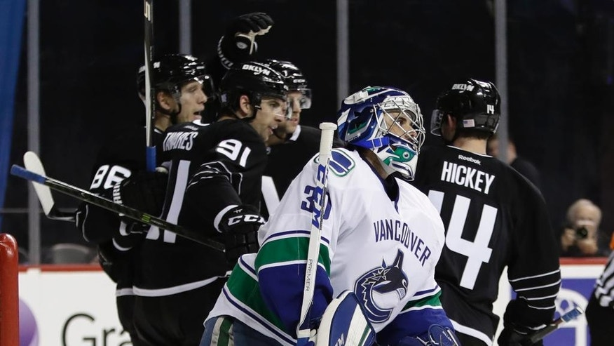 Vancouver Canucks goalie Ryan Miller (30) reacts as the New York Islanders celebrate a goal by Nikolay Kulemin during the second period of an NHL hockey game Monday, Nov. 7, 2016, in New York. (AP Photo/Frank Franklin II)