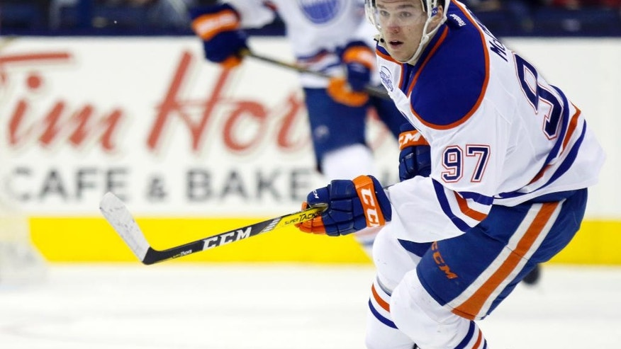 FILE - In this March 4, 2016, file photo, Edmonton Oilers' Connor McDavid works for the puck against the Columbus Blue Jackets during an NHL hockey game in Columbus, Ohio. Connor McDavid grew up idolizing Sidney Crosby. Now the Edmonton Oilers young star gets a chance to face Crosby in the NHL for the first time on Tuesday when the Oilers visit the Pittsburgh Penguins. (AP Photo/Paul Vernon. File)