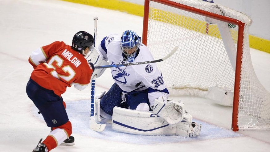 Florida Panthers center Denis Malgin (62) attempts a shot at Tampa Bay Lightning goalie Ben Bishop (30) during the second period of an NHL hockey game, Monday, Nov. 7, 2016, in Sunrise, Fla. (AP Photo/Wilfredo Lee)