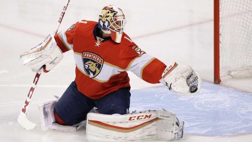 Florida Panthers goalie Roberto Luongo makes a save during the first period of an NHL hockey game against the Tampa Bay Lightning, Monday, Nov. 7, 2016, in Sunrise, Fla. (AP Photo/Wilfredo Lee)