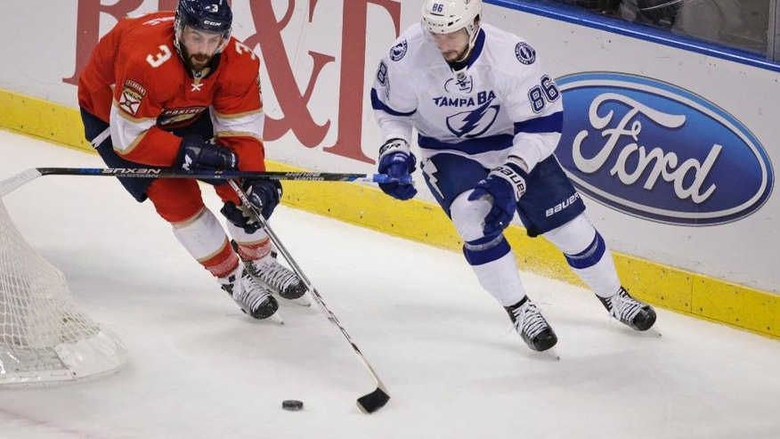 Florida Panthers defenseman Keith Yandle (3) and Tampa Bay Lightning right wing Nikita Kucherov (86) battle for the puck during the first period of an NHL hockey game, Monday, Nov. 7, 2016, in Sunrise, Fla. (AP Photo/Wilfredo Lee)