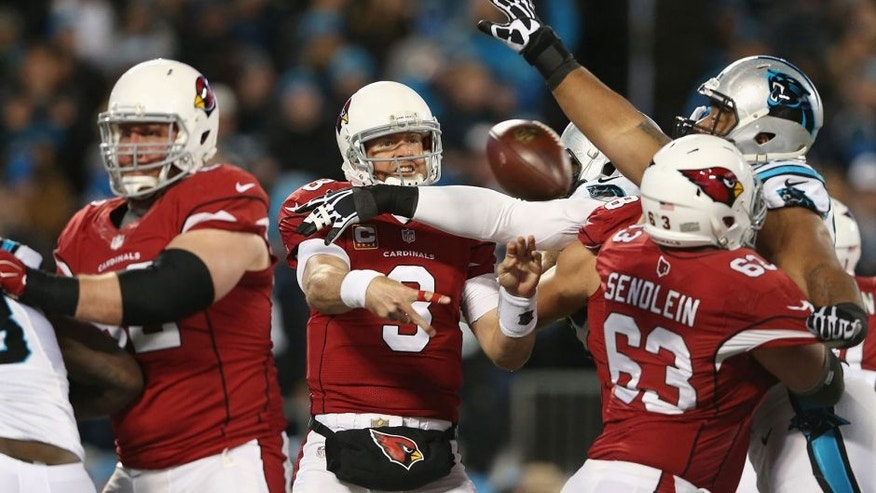 CHARLOTTE, NC - JANUARY 24: Carson Palmer #3 of the Arizona Cardinals throws an incomplete pass in the first half against the Carolina Panthers during the NFC Championship Game at Bank of America Stadium on January 24, 2016 in Charlotte, North Carolina. (Photo by Streeter Lecka/Getty Images)