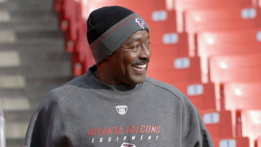 "LANDOVER, MD - DECEMBER 3, 2006: Assistant coach for strength and conditioning Billy ""White Shoes"" Johnson, of the Atlanta Falcons, jogs in the stands prior to a game on December 3, 2006 against the Washington Redskins at Fedex Field in Landover, Maryland. (Photo by: Diamond Images/Getty Images)"