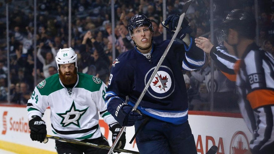 Winnipeg Jets' Patrik Laine (29) celebrates his second goal of the night as Dallas Stars' Jordie Benn (24) skates behind during the second period of an NHL hockey game Tuesday, Nov. 8, 2016, Winnipeg, Manitoba. (John Woods/The Canadian Press via AP)