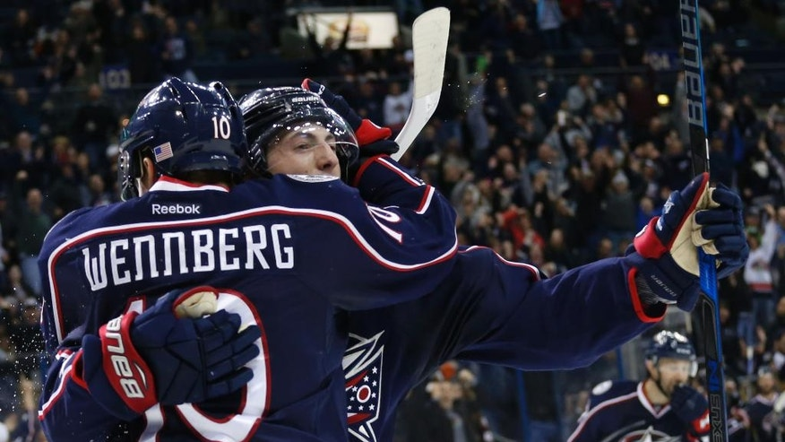 Columbus Blue Jackets' Zach Werenski, right, celebrates his game-winning goal against the Anaheim Ducks with teammate Alexander Wennberg, of Sweden, during overtime of an NHL hockey game Wednesday, Nov. 9, 2016, in Columbus, Ohio. The Blue Jackets won 3-2. (AP Photo/Jay LaPrete)