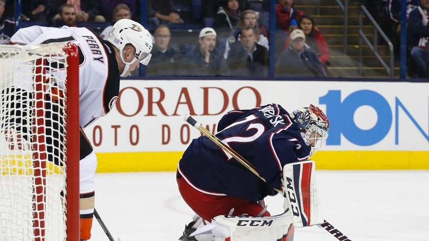 Columbus Blue Jackets' Sergei Bobrovsky, right, of Russia, makes a save as Anaheim Ducks' Corey Perry looks for the rebound during the first period of an NHL hockey game Wednesday, Nov. 9, 2016, in Columbus, Ohio. The Blue Jackets beat the Ducks 3-2 in overtime. (AP Photo/Jay LaPrete)