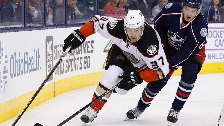 Anaheim Ducks' Nick Ritchie, left, and Columbus Blue Jackets' Markus Nutivaara, of Finland, chase the puck during the third period of an NHL hockey game Wednesday, Nov. 9, 2016, in Columbus, Ohio. The Blue Jackets won 3-2 in overtime. (AP Photo/Jay LaPrete)