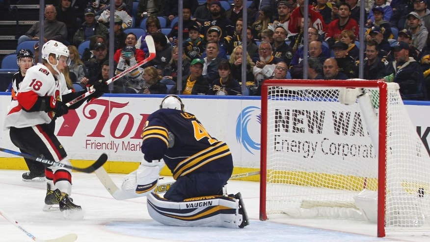 Ottawa Senators' Ryan Dzingel (18) puts the puck past Buffalo Sabres goalie Robin Lehner (40) during the second period of an NHL hockey game, Wednesday, Nov. 9, 2016, in Buffalo, N.Y. (AP Photo/Jeffrey T. Barnes)
