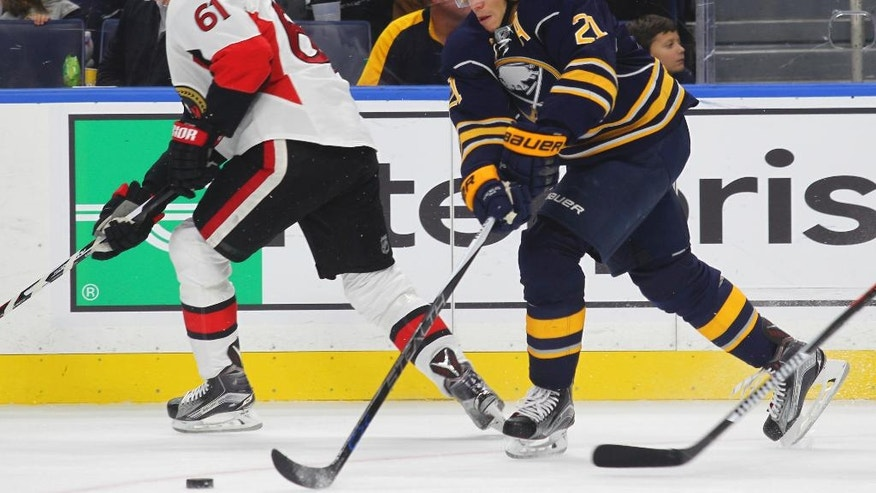 Buffalo Sabres' Kyle Okposo(21) controls the puck against the Ottawa Senators during the second period of an NHL hockey game, Wednesday, Nov. 9, 2016, in Buffalo, N.Y. (AP Photo/Jeffrey T. Barnes)