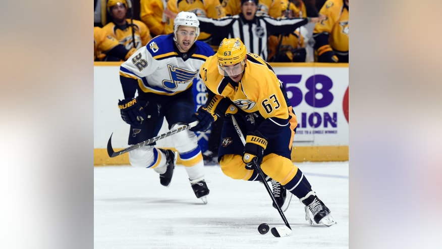 Nashville Predators center Mike Ribeiro (63) moves the puck in front of St. Louis Blues defenseman Kevin Shattenkirk (22) during the second period of an NHL hockey game Thursday, Nov. 10, 2016, in Nashville, Tenn. (AP Photo/Mark Zaleski)