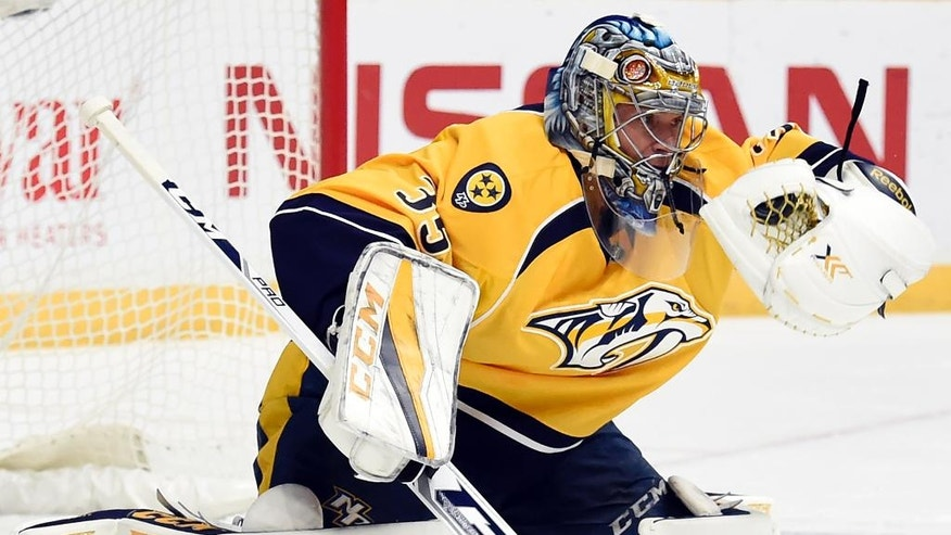 Nashville Predators goalie Pekka Rinne, of Finland, gloves a St. Louis Blues shot during the first period of an NHL hockey game Thursday, Nov. 10, 2016, in Nashville, Tenn. (AP Photo/Mark Zaleski)