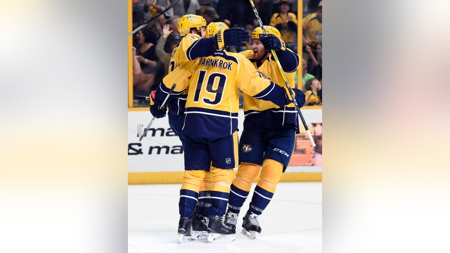 Nashville Predators center Calle Jarnkrok (19), of Sweden, celebrates with left wing Colin Wilson, left, and defenseman Matt Irwin, right, after Jarnkrok scored a goal against the St. Louis Blues during the second period of an NHL hockey game Thursday, Nov. 10, 2016, in Nashville, Tenn. (AP Photo/Mark Zaleski)