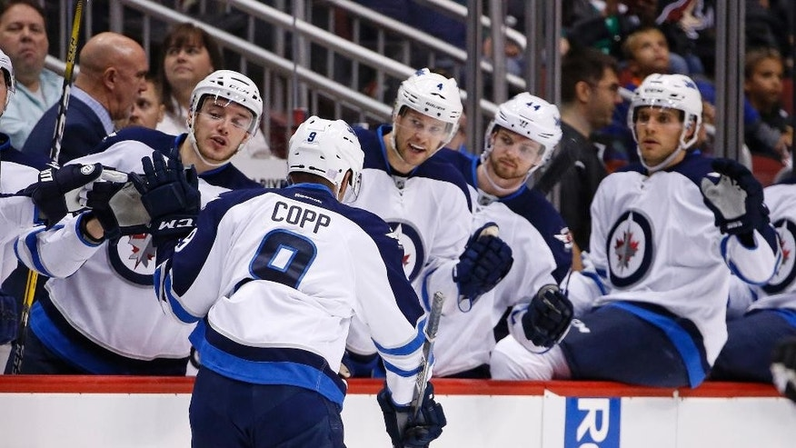 Winnipeg Jets center Andrew Copp (9) celebrates his goal against the Arizona Coyotes with Marko Dano, left, Paul Postma (4), Josh Morrissey (44) and Ben Chiarot, right, during the first period of an NHL hockey game Thursday, Nov. 10, 2016, in Glendale, Ariz. (AP Photo/Ross D. Franklin)