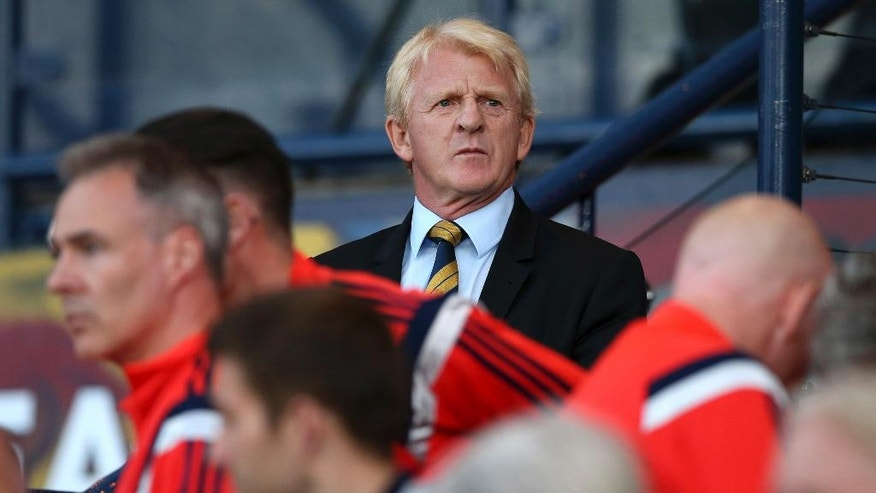 FILE- In this file photo dated Monday Sept. 7, 2015, Scotland's manager Gordon Strachan looks out before the Euro 2016 Group D qualifying soccer match at Hampden Park, Glasgow, Scotland.  The latest instalment of international soccer's oldest rivalry against England on Friday Nov. 11, 2016, is expected to be a jarring reminder for Scotland of just how far the team has declined, and Strachan decries the standard of young players incapable of improving the situation.  (AP Photo/Scott Heppell, FILE)