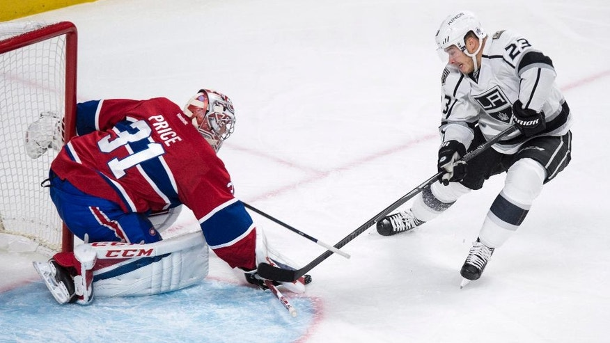 Montreal Canadiens goalie Carey Price stops a shot by Los Angeles Kings' Dustin Brown during the second period of an NHL hockey game Thursday, Nov. 10, 2016, in Montreal. (Paul Chiasson/The Canadian Press via iAP)