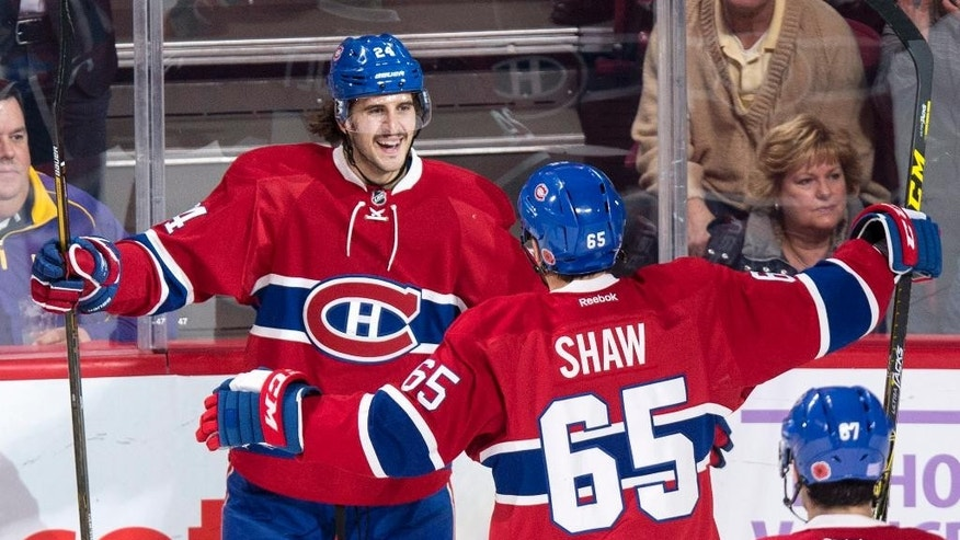 Montreal Canadiens' Phillip Danault, left, celebrates his goal past Los Angeles Kings goalie Peter Budaj with teammate Andrew Shaw during the second period of an NHL hockey game Thursday, Nov. 10, 2016, in Montreal. (Paul Chiasson/The Canadian Press via iAP)
