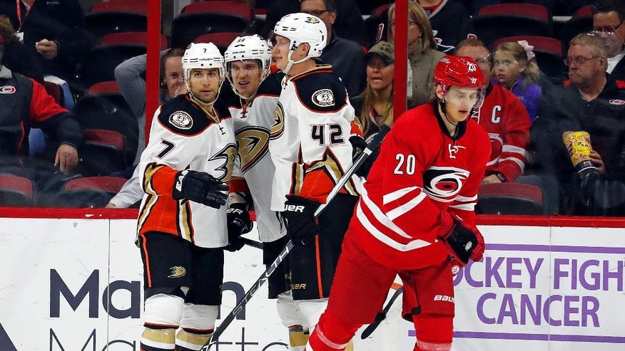 Anaheim Ducks' Jakob Silfverberg, center, celebrates his goal with teammates Andrew Cogliano (7) and Josh Manson (42) as Carolina Hurricanes' Sebastian Aho (20) skates by during the second period of an NHL hockey game, Thursday, Nov. 10, 2016, in Raleigh, N.C. (AP Photo/Karl B DeBlaker)