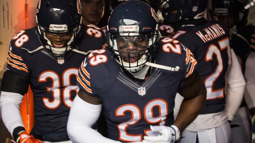 CHICAGO, IL - JANUARY 03: Harold Jones-Quartey #29 of the Chicago Bears runs out with teammates to the field for warm-ups prior to the game against the Detroit Lions at Soldier Field on January 3, 2016 in Chicago, Illinois. (Photo by Kena Krutsinger/Getty Images)