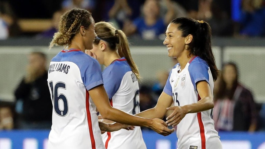 United States' Christen Press, right, celebrates her goal with teammate Lynn Williams (16) during the first half of an exhibition soccer match against Romania on Thursday, Nov. 10, 2016, in San Jose, Calif. (AP Photo/Marcio Jose Sanchez)