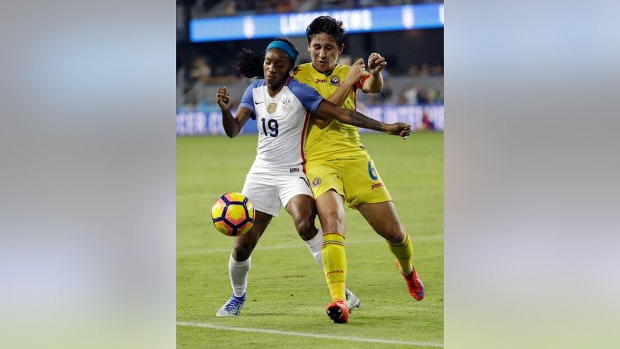 United States' Crystal Dunn, left, is defended by Romania's Maria Ficzay during the first half of an exhibition soccer match Thursday, Nov. 10, 2016, in San Jose, Calif. (AP Photo/Marcio Jose Sanchez)