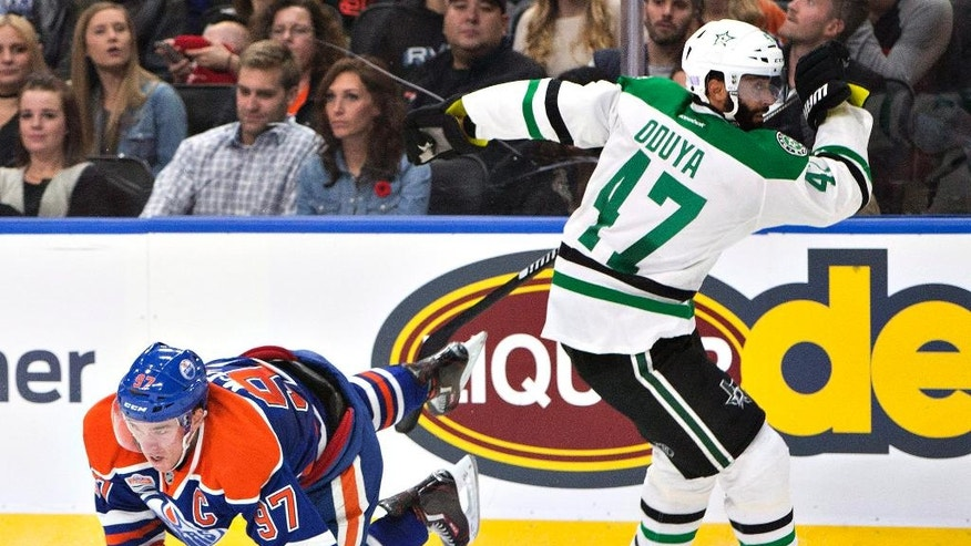 Dallas Stars' Johnny Oduya (47) checks Edmonton Oilers' Connor McDavid (97) during the second period of an NHL hockey game Friday, Nov. 11, 2016, in Edmonton, Alberta. (Jason Franson/The Canadian Press via AP)