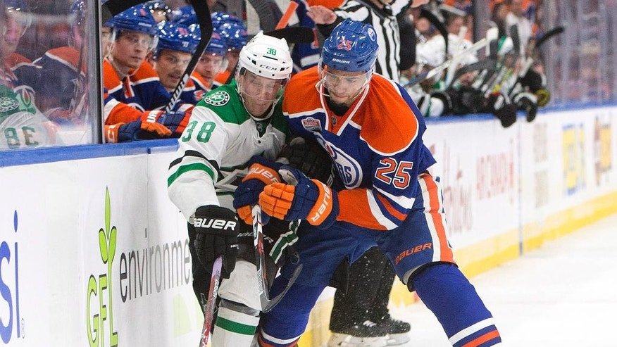 Dallas Stars' Lauri Korpikoski (38) and Edmonton Oilers' Darnell Nurse (25) compete for the puck during the third period of an NHL hockey game Friday, Nov. 11, 2016, in Edmonton, Alberta. (Jason Franson/The Canadian Press via AP)