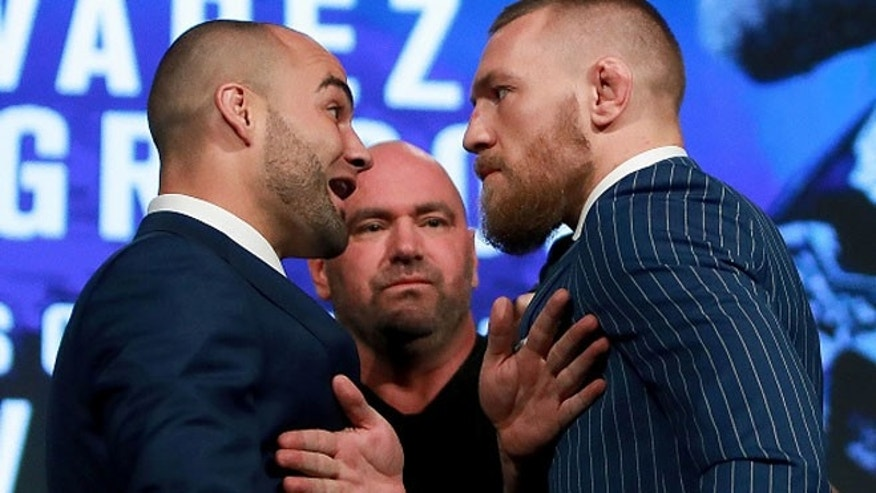 Conor McGregor and Eddie Alvarez face-off at the UFC 205 press conference on September 27, 2016.