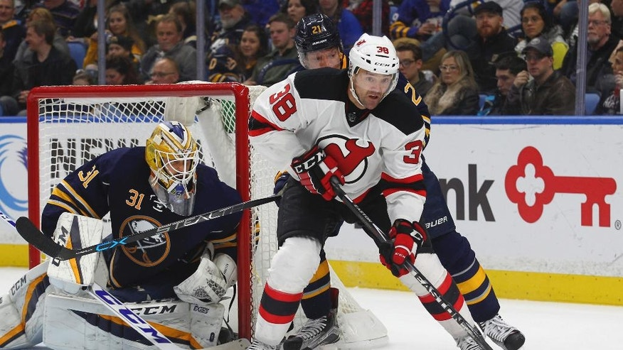Buffalo Sabres goalie Anders Nilsson (31) watches as New Jersey Devils left wing Vernon Fiddler (38) passes during the second period of an NHL hockey game, Friday, Nov. 11, 2016, in Buffalo, N.Y. (AP Photo/Jeffrey T. Barnes)