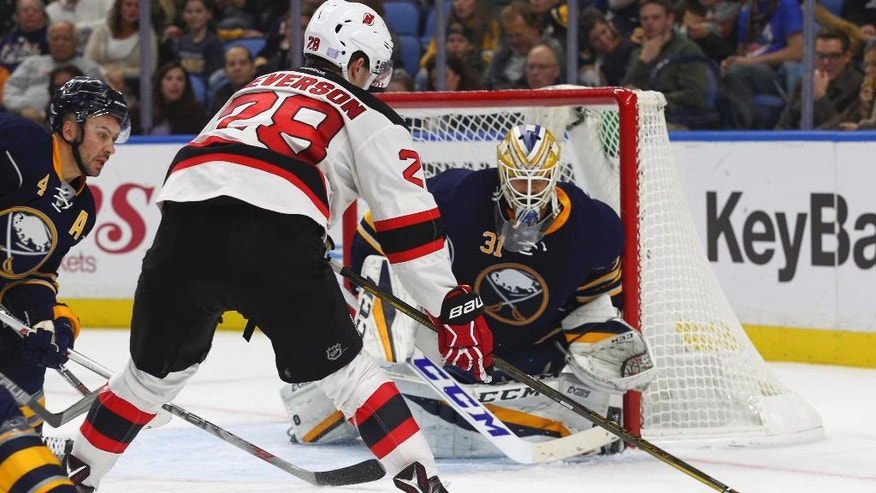 Buffalo Sabres goalie Anders Nilsson (31) defends the net against New Jersey Devils defenseman Damon Severson (28) during the second period of an NHL hockey game, Friday, Nov. 11, 2016, in Buffalo, N.Y. (AP Photo/Jeffrey T. Barnes)