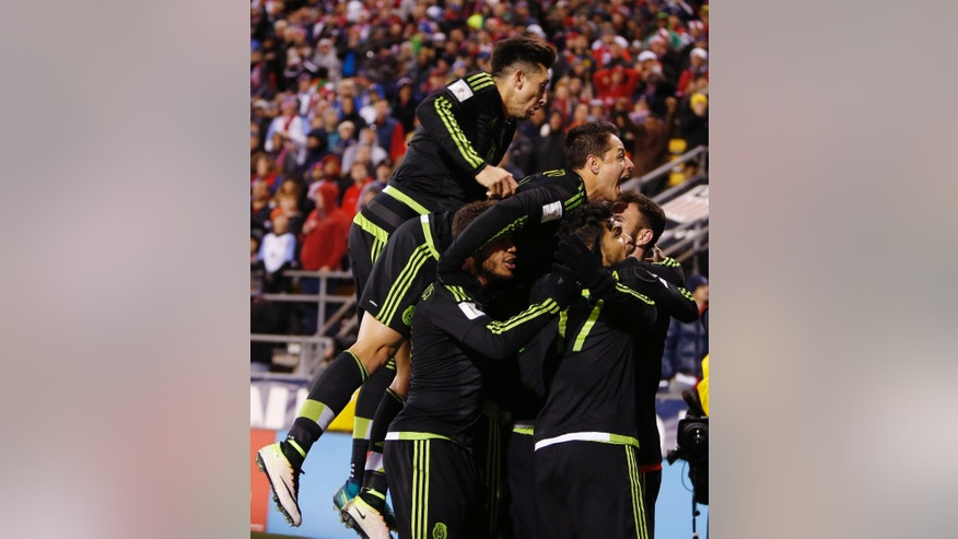 Mexico players celebrate their winning goal against the United States during the second half of a World Cup qualifying soccer match Friday, Nov. 11, 2016, in Columbus, Ohio. (AP Photo/Jay LaPrete)