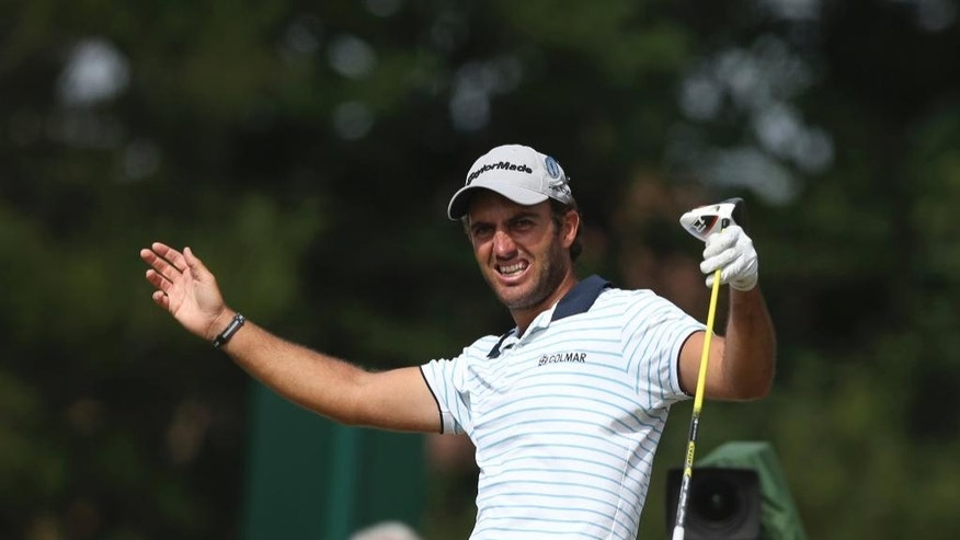 FILE - A Sunday July 20, 2014 file photo of Edoardo Molinari of Italy at the British Open Golf championship at the Royal Liverpool golf club, Hoylake, England. Next Thursday, Nov. 17, 2016, 5,000 miles away from the opening round of the European Tour's lucrative, season-ending World Tour Championship in Dubai, the final stage of the tour's Q School will reach its climax just outside Barcelona. (AP Photo/Jon Super, File)