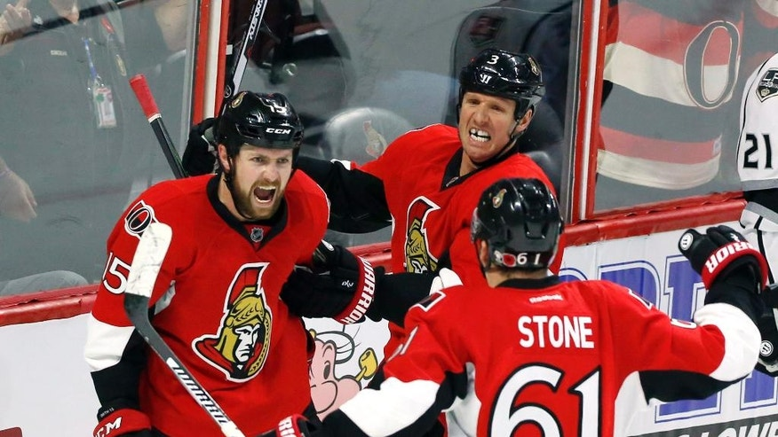 Ottawa Senators Zack Smith (15) celebrates his goal against the Los Angeles Kings with teammates Mark Stone (61) and Marc Methot (3) during third-period NHL hockey game action in Ottawa, Ontario, Friday, Nov. 11, 2016. (Fred Chartrand/The Canadian Press via AP)