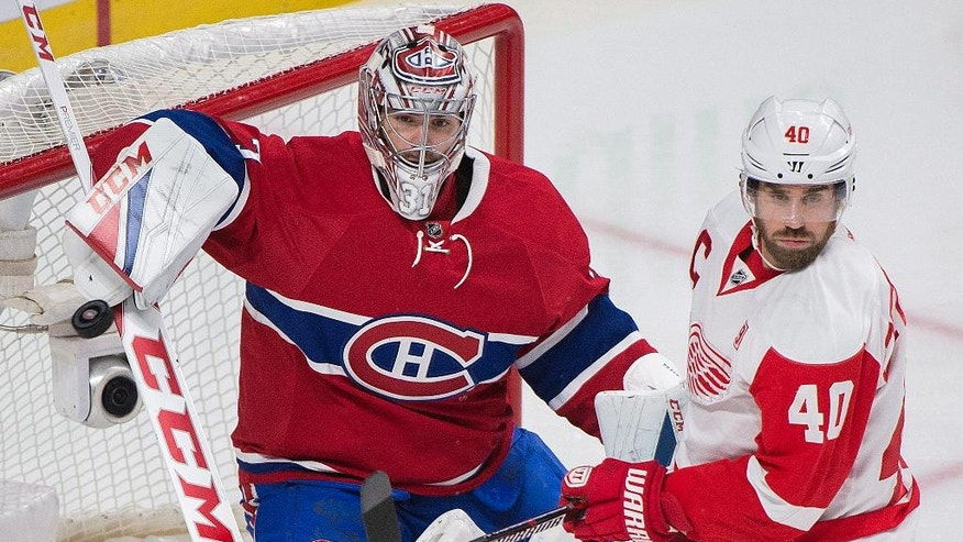Detroit Red Wings' Henrik Zetterberg moves in on Montreal Canadiens goaltender Carey Price during the second period of an NHL hockey game in Montreal, Saturday, Nov. 12, 2016. (Graham Hughes/The Canadian Press via AP)