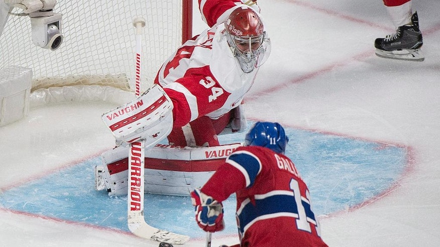 Detroit Red Wings goaltender Petr Mrazek makes a save against Montreal Canadiens' Brendan Gallagher during the third period of an NHL hockey game in Montreal, Saturday, Nov. 12, 2016. (Graham Hughes/The Canadian Press via AP)