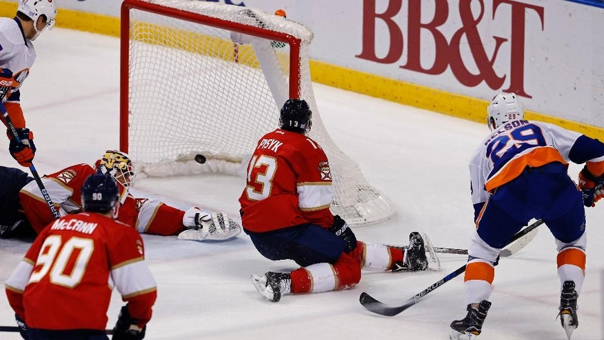 New York Islanders left wing Brock Nelson (29) watches his first-period goal as Florida Panthers goalie Roberto Luongo (1) fails to make the save in an NHL hockey game, Saturday, Nov. 12, 2016, in Sunrise, Fla. Panthers' Jared McCann (90) and Mark Pysyk (13) look on. (AP Photo/Joe Skipper)
