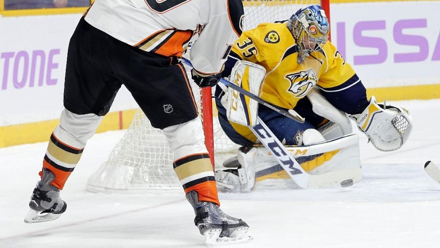 Nashville Predators goalie Pekka Rinne (35), of Finland, blocks a shot by Anaheim Ducks right wing Corey Perry (10) during the third period of an NHL hockey game Saturday, Nov. 12, 2016, in Nashville, Tenn. The Predators won 5-0. (AP Photo/Mark Humphrey)