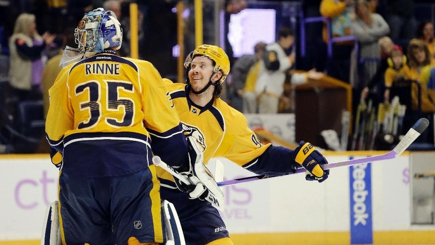 Nashville Predators center Ryan Johansen, right, celebrates with goalie Pekka Rinne (35), of Finland, after the Predators shut out the Anaheim Ducks 5-0 in an NHL hockey game Saturday, Nov. 12, 2016, in Nashville, Tenn. (AP Photo/Mark Humphrey)
