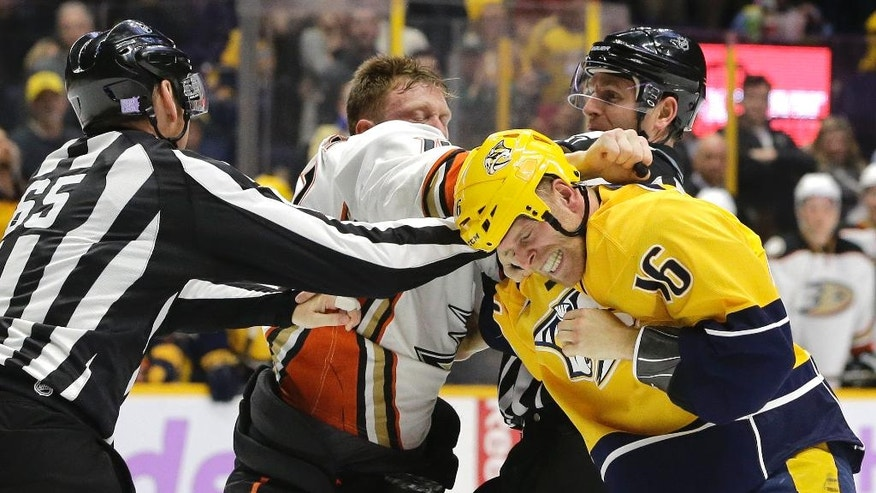 Nashville Predators center Cody Bass (16) and Anaheim Ducks defenseman Josh Manson fight in the second period of an NHL hockey game Saturday, Nov. 12, 2016, in Nashville, Tenn. (AP Photo/Mark Humphrey)