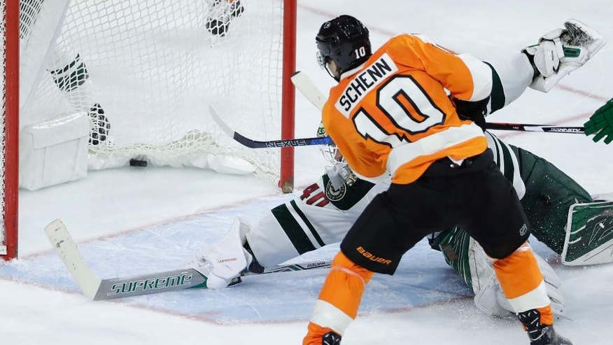 Philadelphia Flyers' Brayden Schenn (10) scores the go-ahead goal past Minnesota Wild's Devan Dubnyk (40) during the third period of an NHL hockey game, Saturday, Nov. 12, 2016, in Philadelphia. Philadelphia won 3-2. (AP Photo/Matt Slocum)