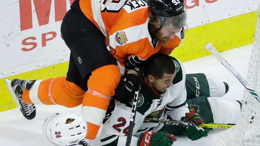 Philadelphia Flyers' Jakub Voracek, left, and Minnesota Wild's Matt Dumba collide during the third period of an NHL hockey game, Saturday, Nov. 12, 2016, in Philadelphia. Philadelphia won 3-2. (AP Photo/Matt Slocum)