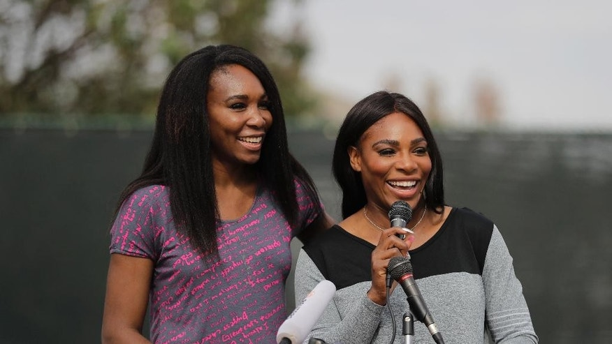 CORRECTS PARK SPELLING TO LUEDERS, NOT LEUDERS - Sister Venus and Serena Williams, right, speak during a dedication ceremony of the Lueders Park tennis courts Saturday, Nov. 12, 2016, in Compton, Calif. The courts were dedicated in their name. (AP Photo/Jae C. Hong)