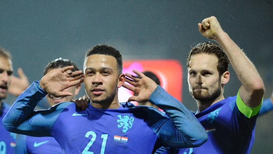 Netherland's Memphis Depay, left, reacts next to his team mate Daley Bling after scoring the 1-3 goal against Luxembourg during their World Cup Group A qualifying soccer match at the Josy Barthel stadium in Luxembourg on Sunday, Nov 13, 2016. (AP Photo/Laurent Dubrule)