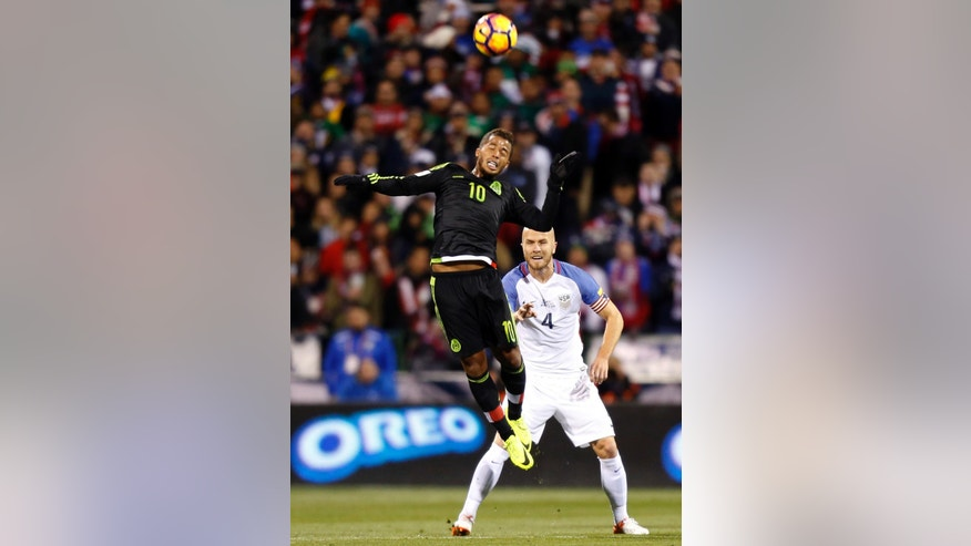 Mexico's Giovani Dos Santos, left, heads the ball as United States' Michael Bradley defends during the first half of a World Cup qualifying soccer match Friday, Nov. 11, 2016, in Columbus, Ohio. (AP Photo/Jay LaPrete)