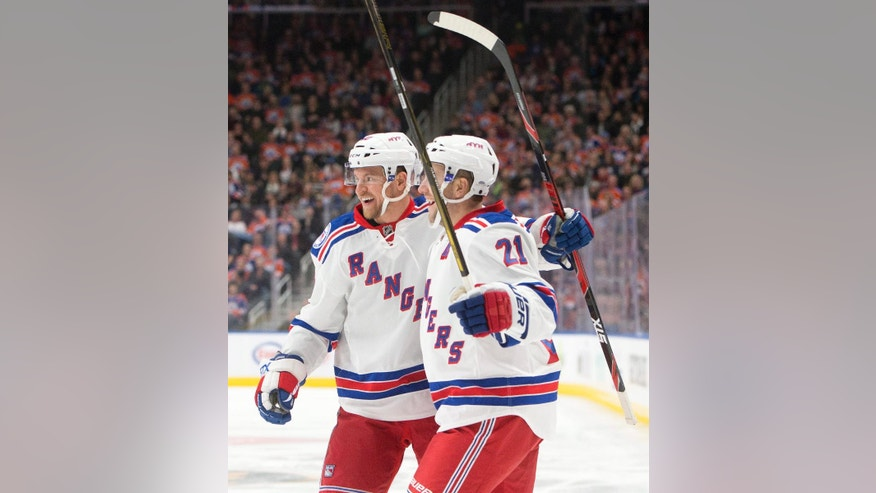 New York Rangers' Michael Grabner (40) and Derek Stepan (21) celebrate a goal against the Edmonton Oilers' during the first period of an NHL hockey game in Edmonton, Alberta, Sunday, Nov. 13, 2016. (Jason Franson/The Canadian Press via AP)
