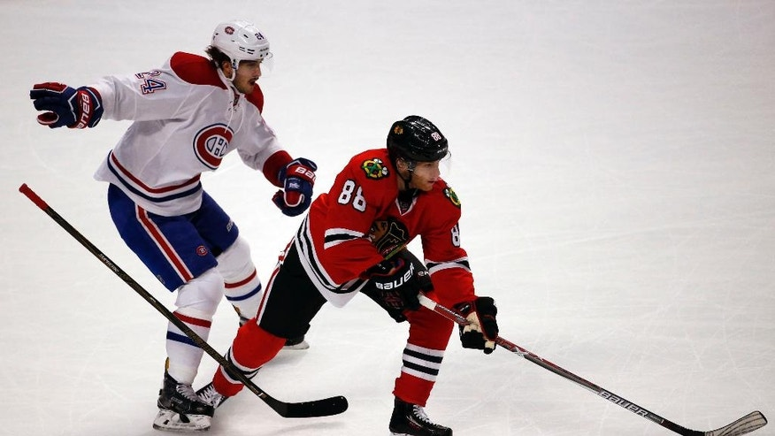 Chicago Blackhawks right wing Patrick Kane, right, controls the puck past Montreal Canadiens left wing Phillip Danault during the first period of an NHL hockey game in Chicago, Sunday, Nov. 13, 2016. (AP Photo/Nam Y. Huh)