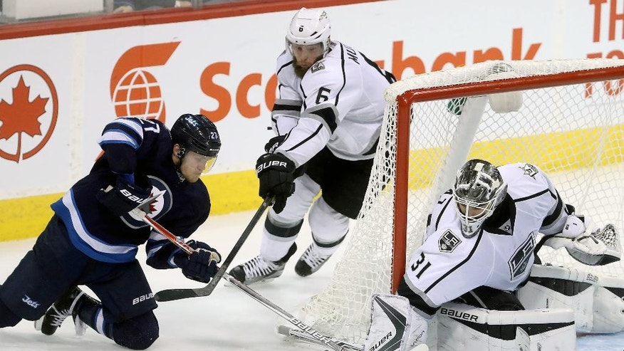Winnipeg Jets' Nikolaj Ehlers (27) tries a wraparound on Los Angeles Kings goaltender Peter Budaj (31) during the third period of an NHL hockey game in Winnipeg, Manitoba, Sunday, Nov. 13, 2016. (Trevor Hagan/The Canadian Press via AP)