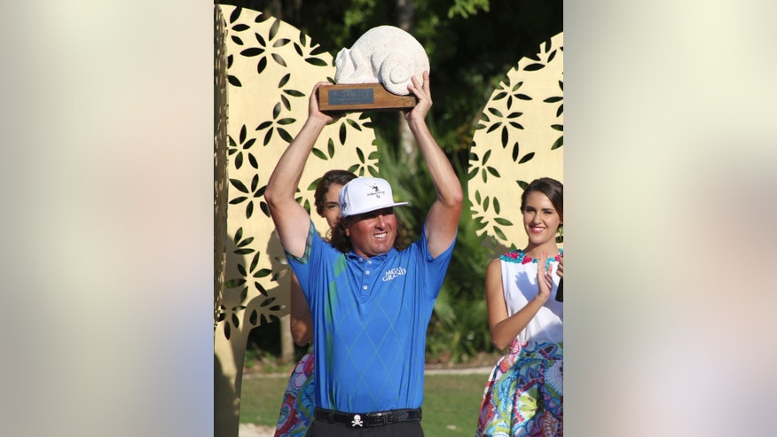 Pat Perez of the United States holds up his trophy after he won the OHL Classic at Mayakoba golf tournament in Playa del Carmen, Mexico, Sunday, Nov. 13, 2016. (AP Photo/Israel Leal)