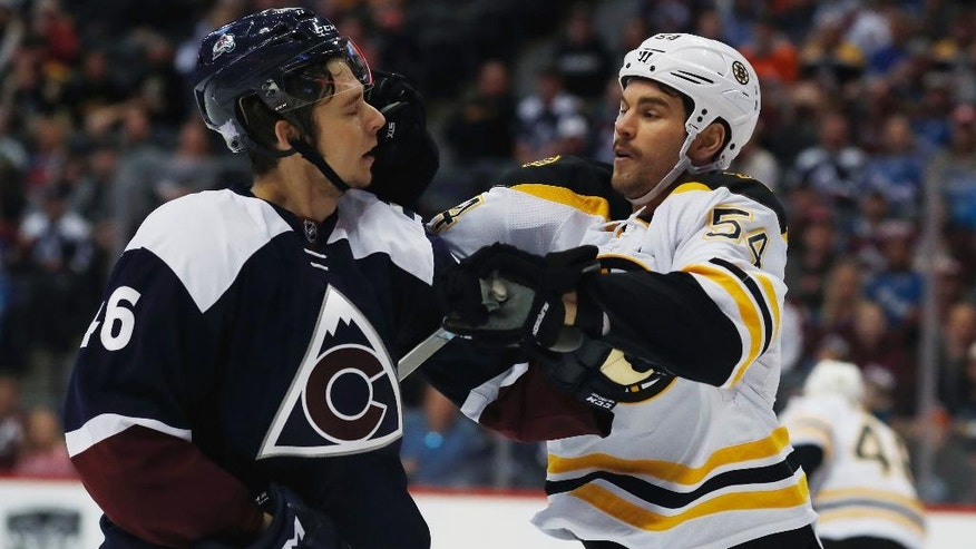 Boston Bruins defenseman Adam McQuaid, right, fights with Colorado Avalanche left wing AJ Greer in the first period of an NHL hockey game, Sunday, Nov. 13, 2016, in Denver. (AP Photo/David Zalubowski)